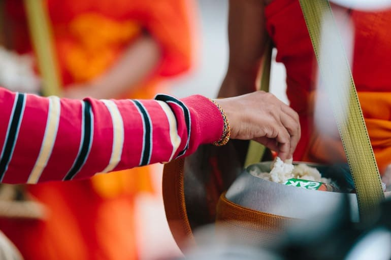 buddhism and food coming together during the round of alms a daily ritual