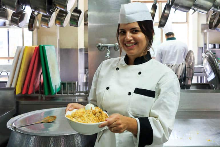serving a hyderabadi biryani in brand cai