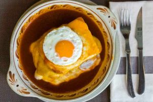 Francesinha sandwich on the plate from Porto, Portugal