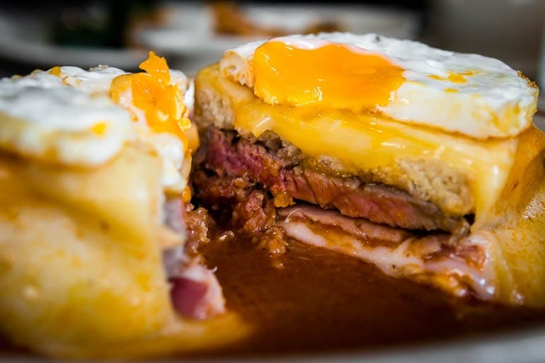 Francesinha from Portugal with many meat and egg on top