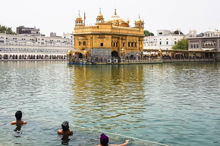 the sarowar is like a pool that surrounds the golden temple for people to bathe as an act of purification