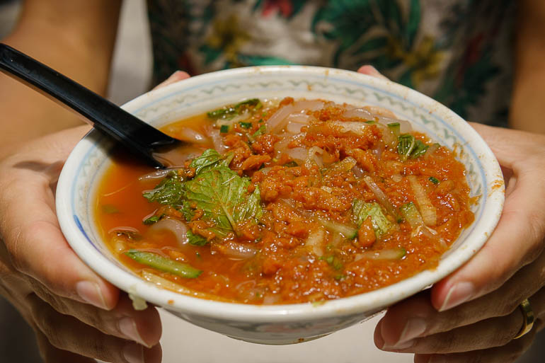 a bowl with Assam Laksa very typical malaysian food