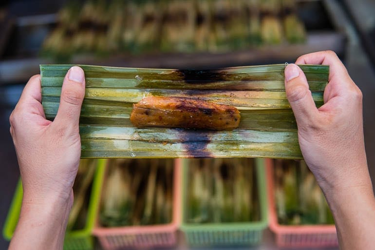 Otak Otak is a snack cooked and grilled inside a banana leaf