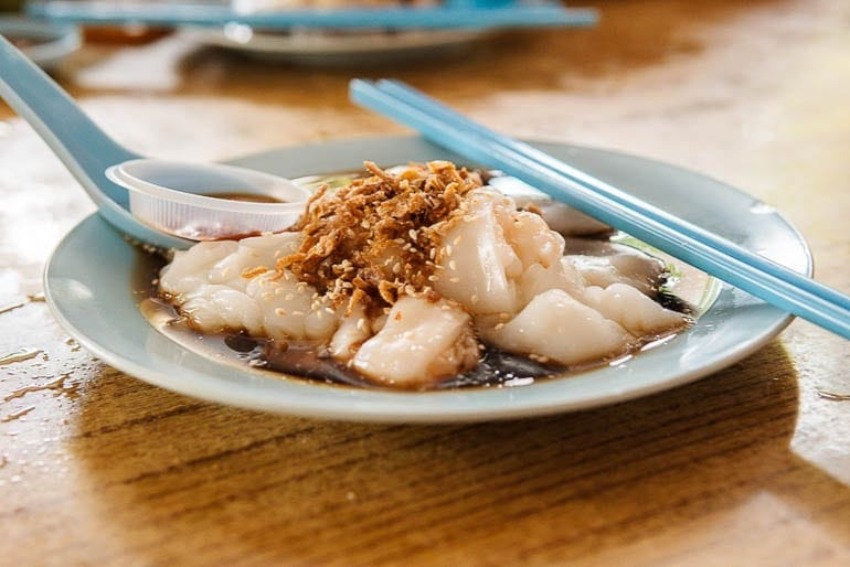 Rice Noodle Roll, a typical malaysian food with soy sauce and brown onions