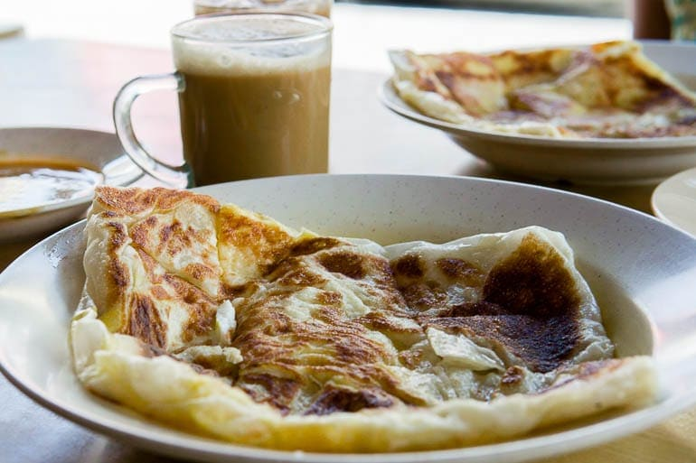 Roti Canai, typical malysian food with curry and teh tarik