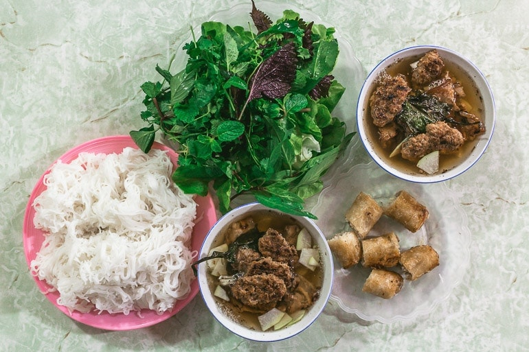 one of most typical Vietnamese food combining fresh rice noodles, pork, broth and fresh herbs