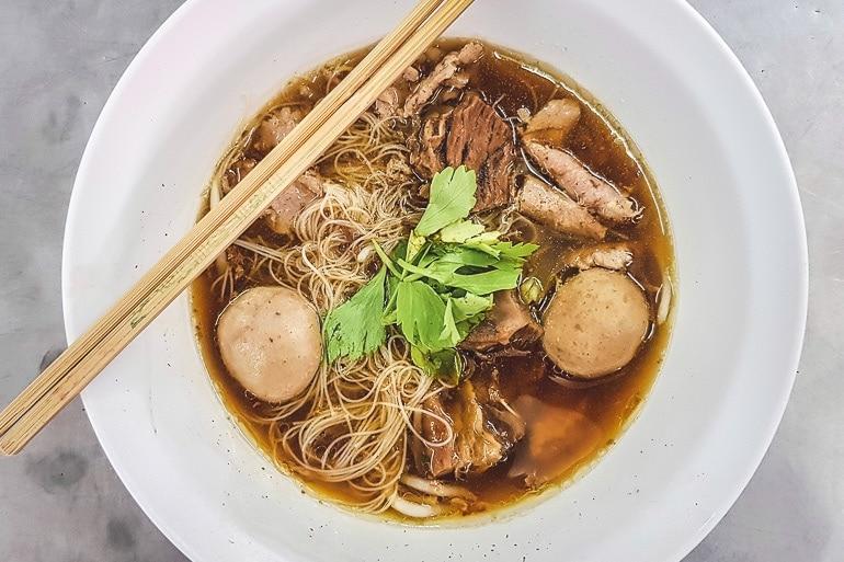 A bowl of Kuay Teow Neua, beef noodle soup popular in Bangkok