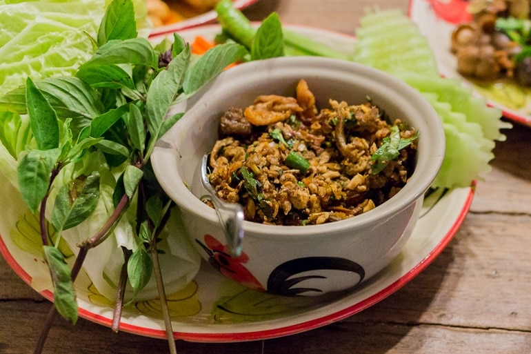 Larb dish served with green leaves