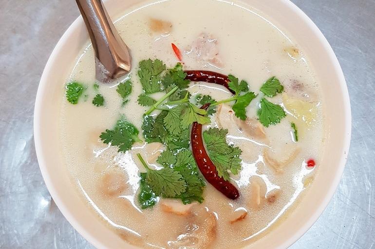 A bowl of Tom Kha Gai, a Thai chicken soup with coconut milk