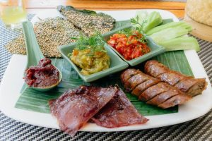 A plate with a variety of Laos Food dishes that represents Lao Cuisine