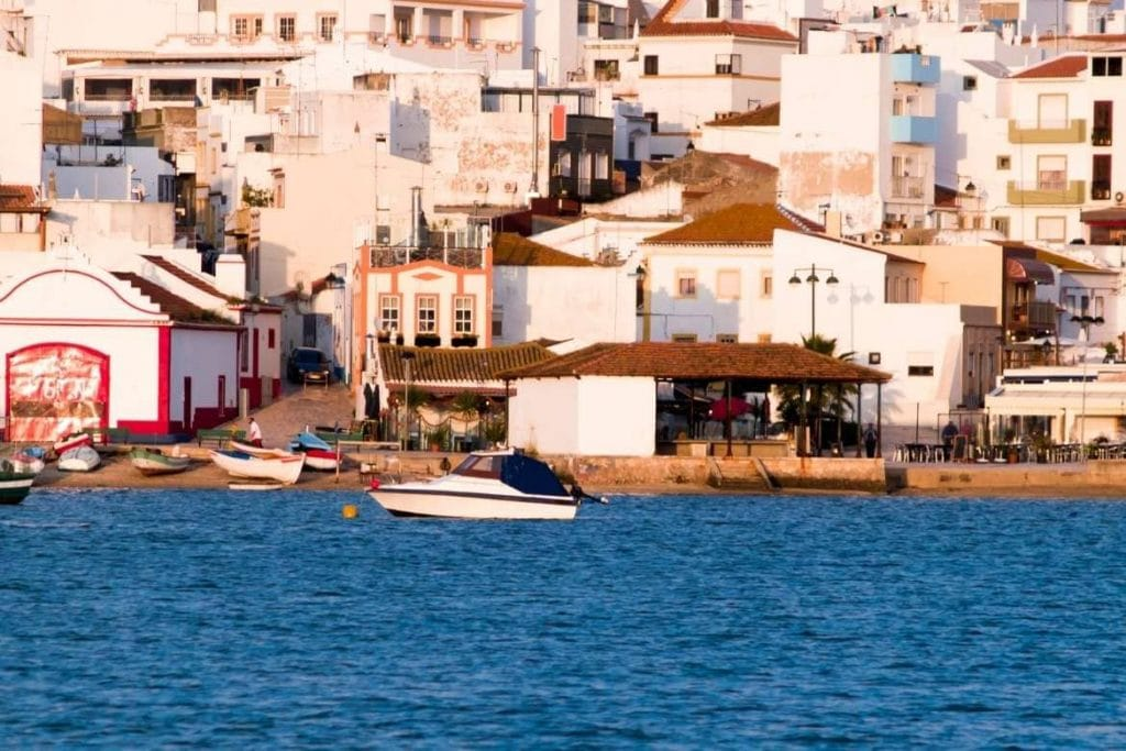 view of the village of Alvor in the Algarve with fishermen's boats and traditional houses