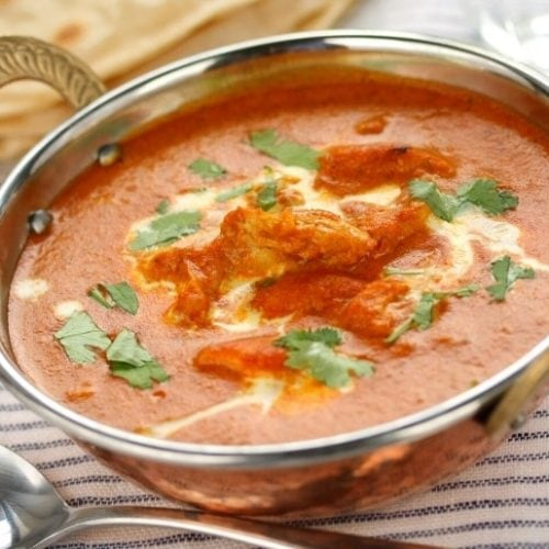 Recipe featured image - a bowl of butter chicken masala, a dish similar to chicken tikka masala