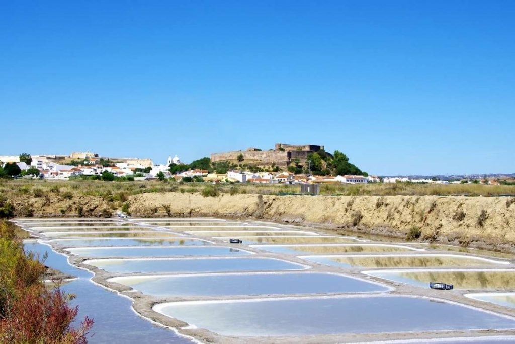 a view of the salt flats with the castle of Castro Marim on the back in the region of Algarve