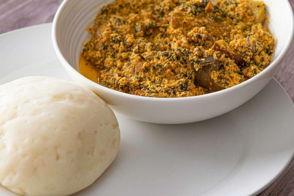 a plate with fufu and egusi, famous soup from Nigeria