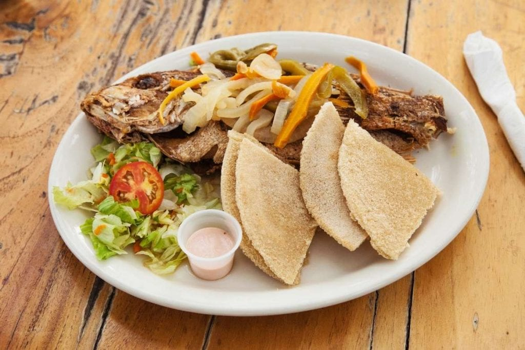 jamaican grilled fish served with bammy, typical easter food
