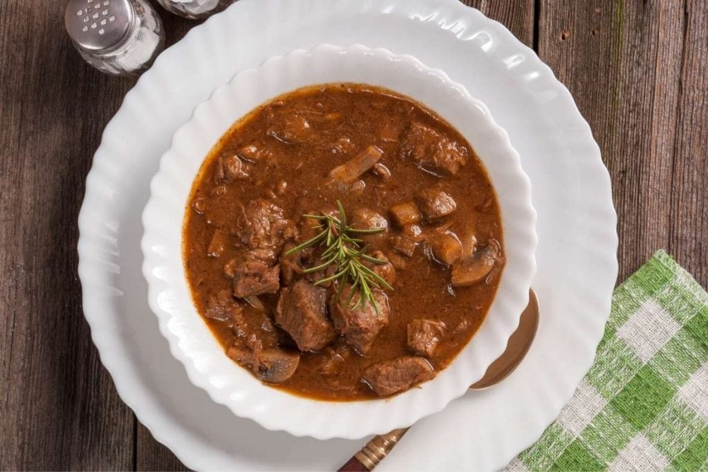 goulash soup on a white plate very traditional dish in Hungary