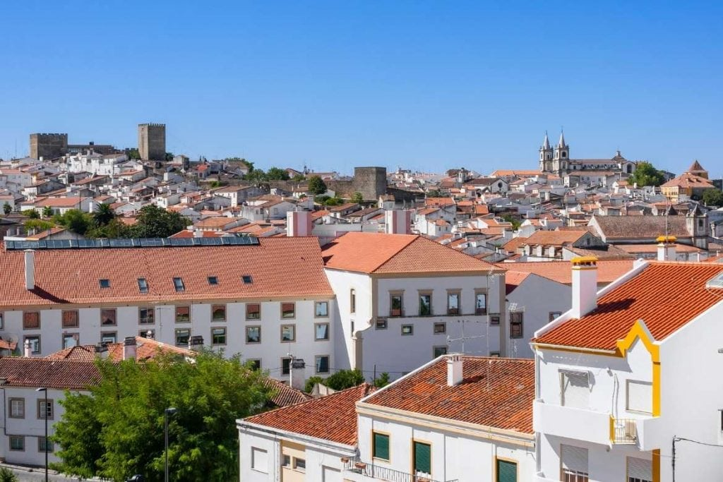 view of Portalegre city in north Alentejo with traditional white houses and the castle and church on the back