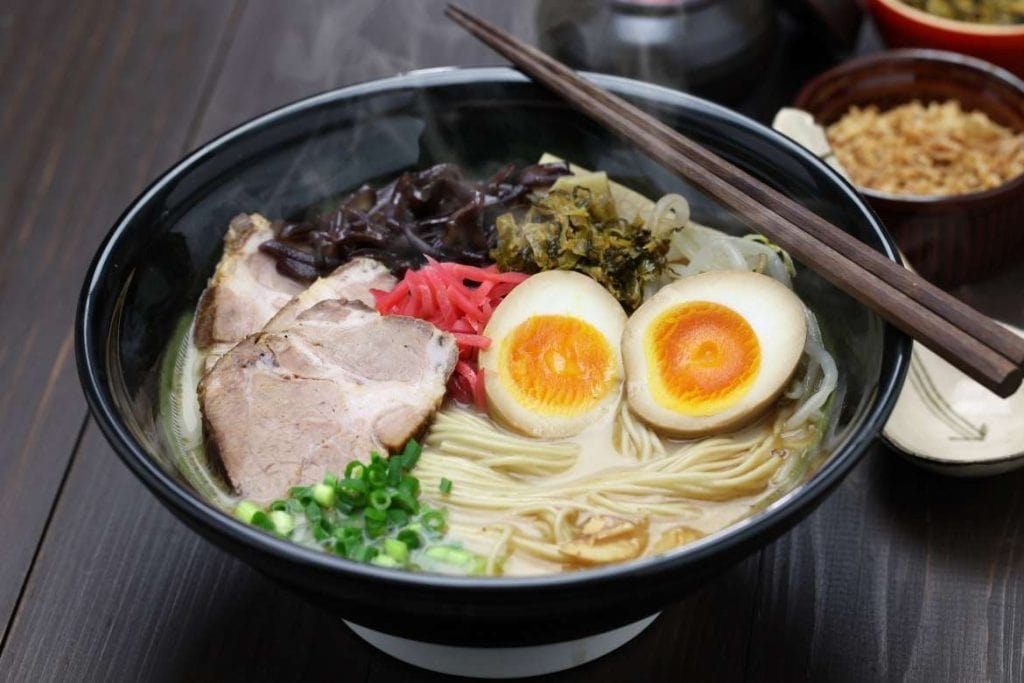 a bowl with many ingredients making up the Japanese ramen soup