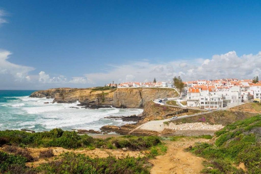 Zambujeira beach with cliffs and white houses on the Alentejo coast