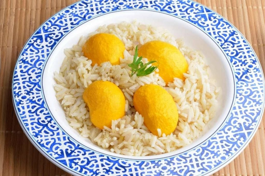 a plate of rice with pequi which is a traditional fruit from cerrado region in Brasil