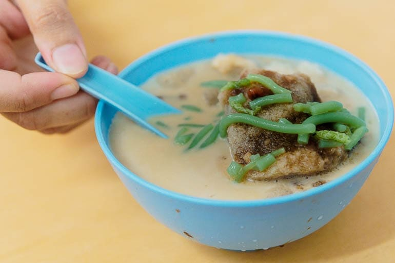 a blue bowl with cendol and shaved ice typical Malaysian dessert