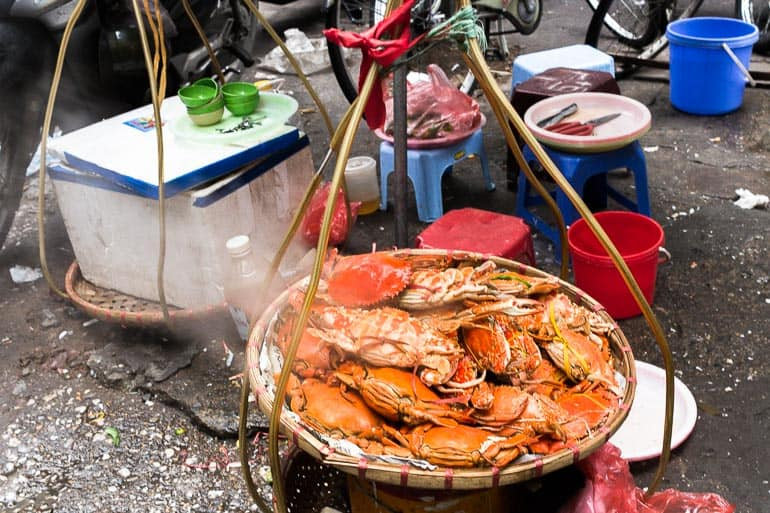 Basket with sea food and crab placed on the street in Hanoi