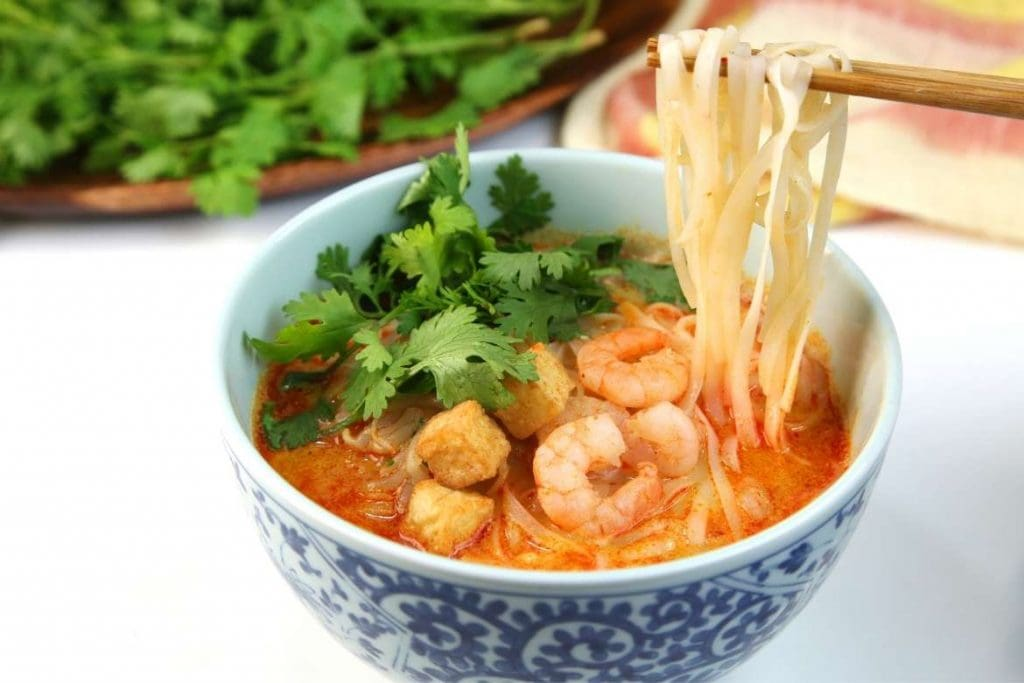 a bowl with curry laksa typical dish of Malaysia