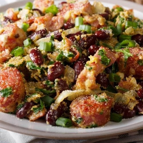 recipe feijao tropeiro dish containing farofa sausage beans bacon and other ingredients typical of Brazil