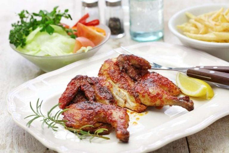 Frango piripiri is a typical portuguese dish consisting of grilled chicken marinated in pepper sauce called piripiri