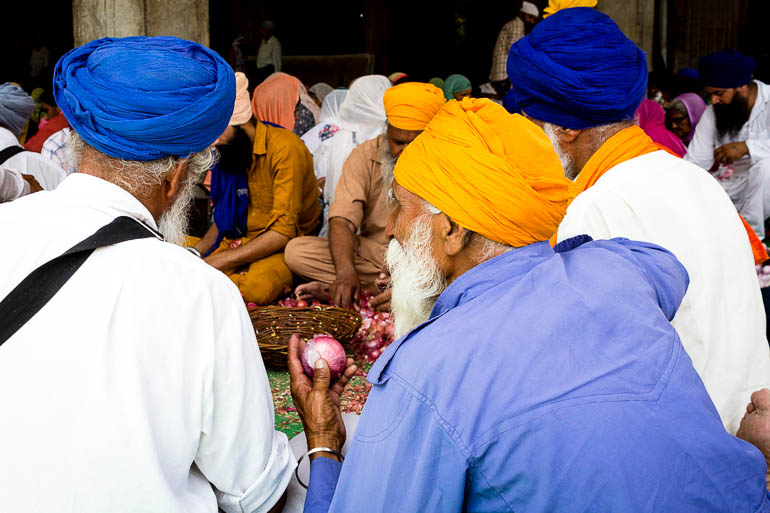 Sikhs helping with the food preparation at Golden Temple