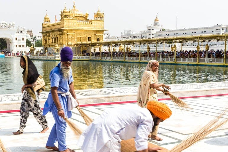 local community helps to clean the Temple