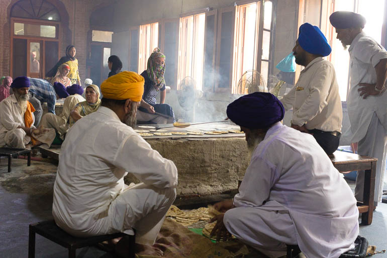 volunteers cooking roti at Golden Temple, a typical Indian bread