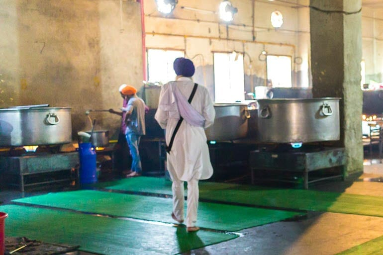 Sikhs cooking the food inside the communal kitchen at Golden Temple