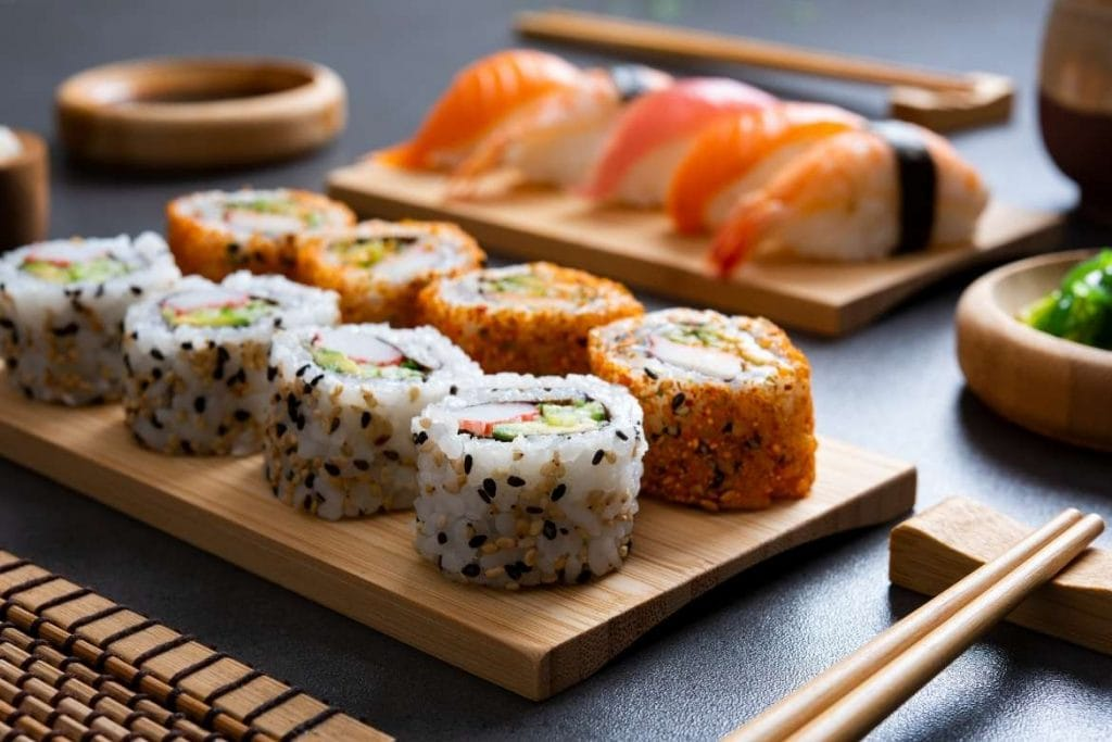 different types of japanese rice sushi on a wood board