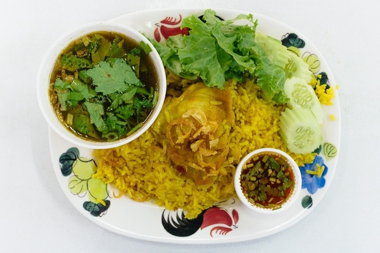 thai style chicken biryani, a Thai dish with yellow rice and chicken influenced by Thai Muslims