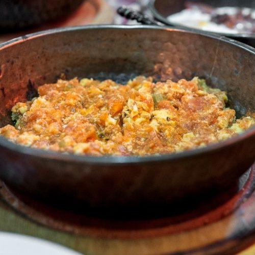 A pan with menemen, turkish scrambled eggs (Recipe)