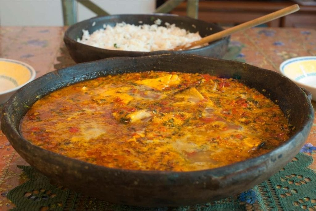 moqueca in the clay pot is a fish stew typical from brazil
