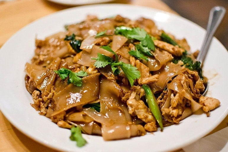 Pad See Ew made with wide noodles and plenty of soy sauce, typical Thai food