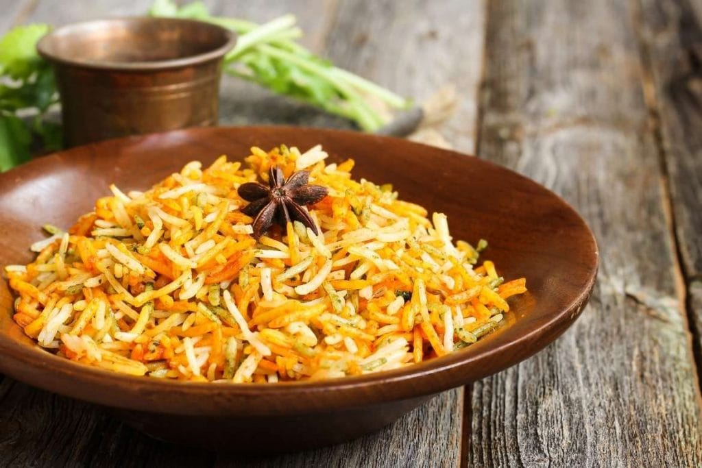 wood plate with pilaf rice dish