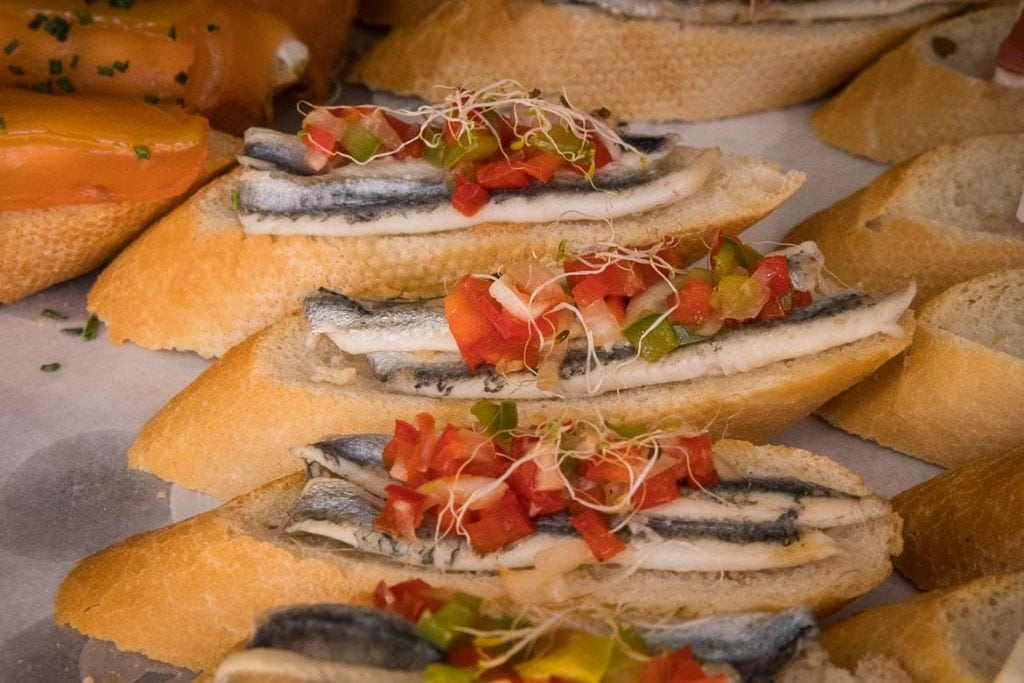 spanish boquerones anchovies in vinegar on a bread with tomatoes served as traditional spanish food