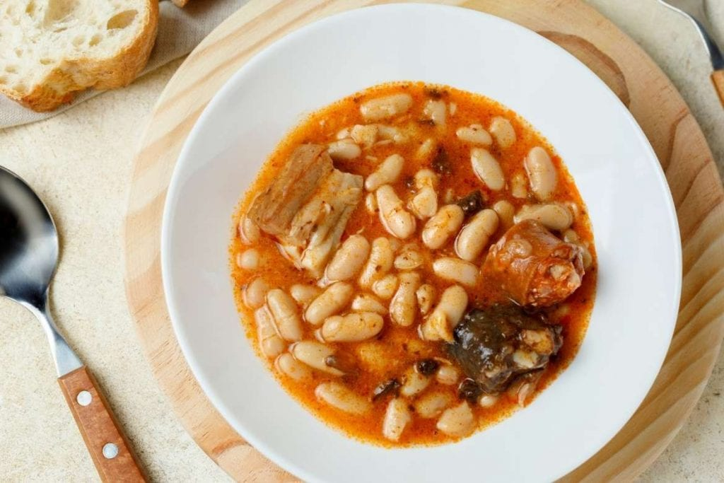 fabadas served on a plate with white beans and sausage is a very traditional and nutritional spanish food