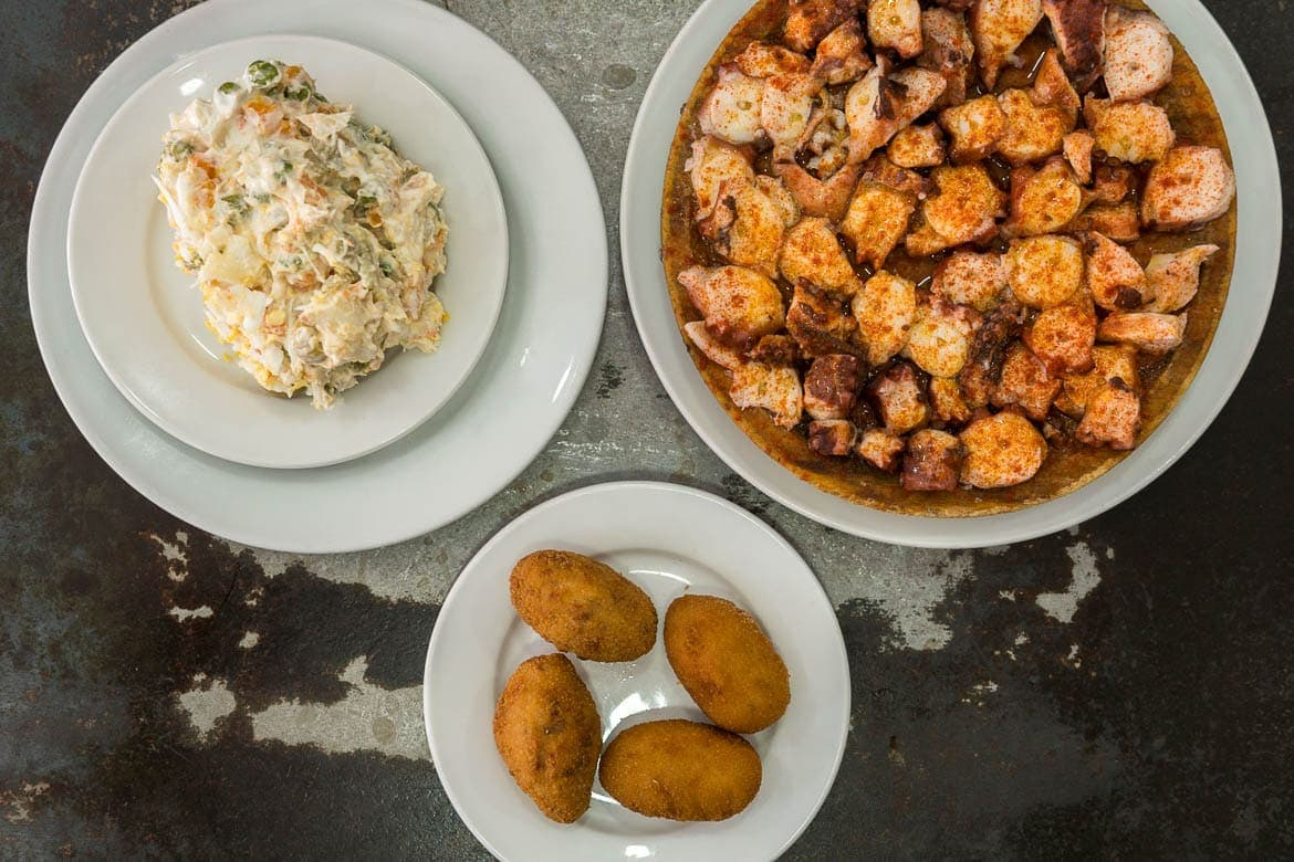 spanish tapas with pulpo ocotpus and russian salad