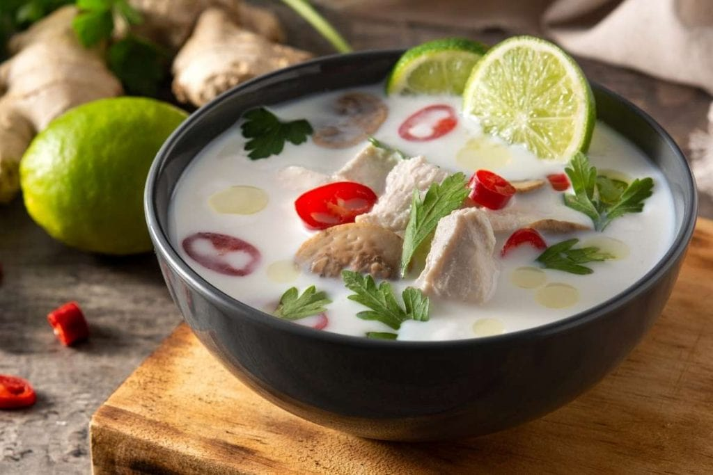 a bowl with tom kha gai typical Thai chicken soup with coconut