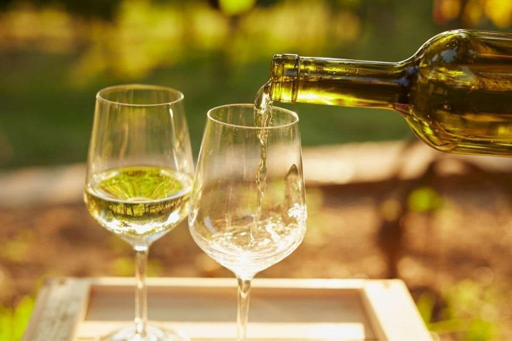 two glasses of green wine