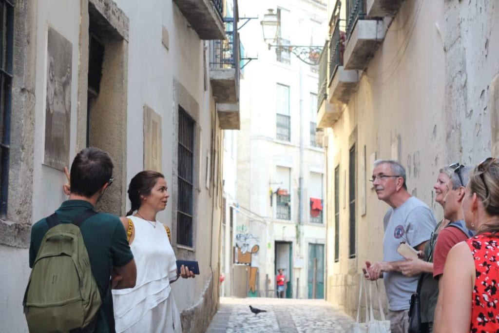 a tour guide showing a image with Portuguese culture