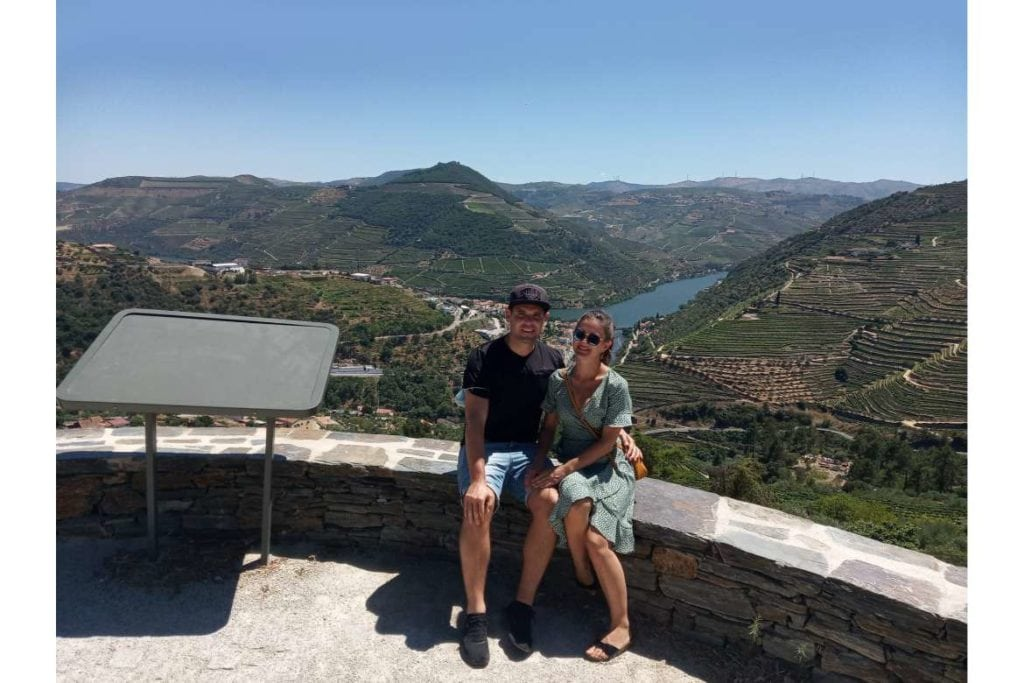 a couple of travelers taking a photo on Douro Valley view during a wine tour in Douro