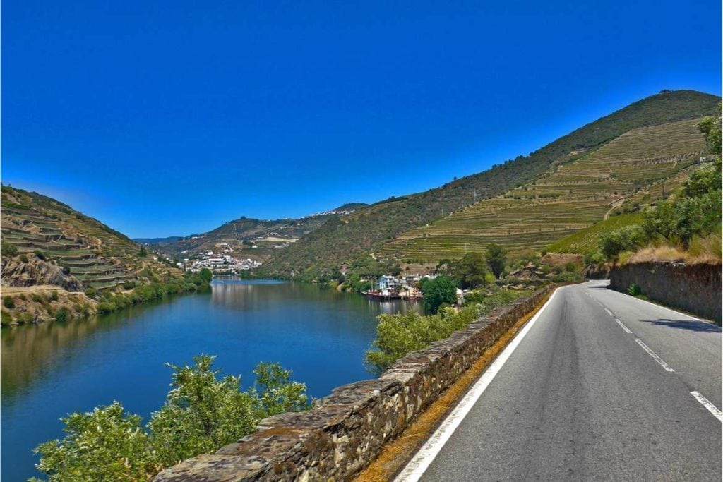 road in the right side and Douro river on the left side, view from the Douro wine tour
