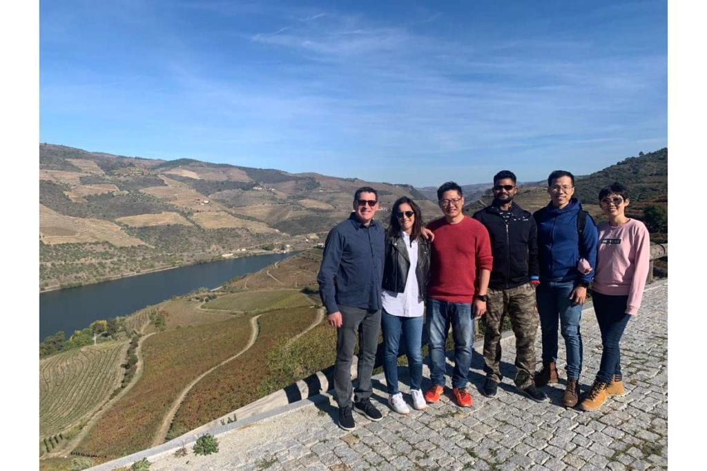 a group o travelers taking a photo in a viewpoint during a wine tour in Douro Valley