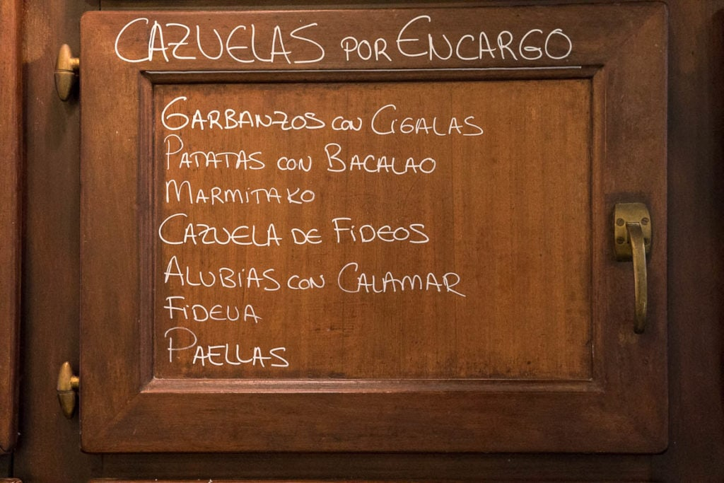 Spanish menu written on a wooden wall