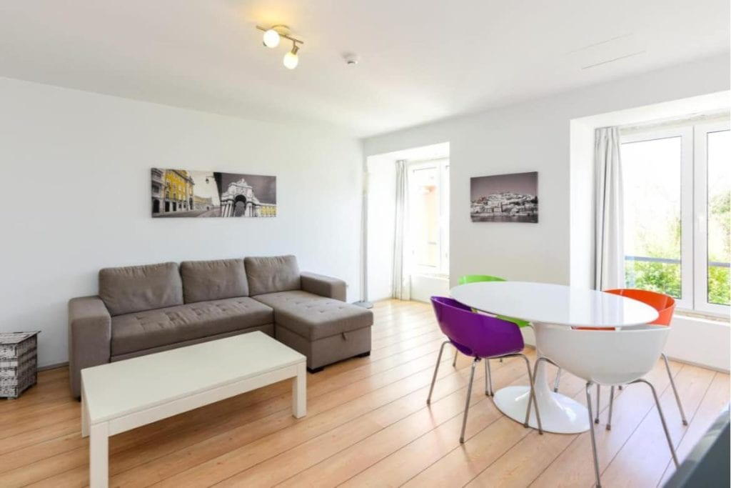 Photo of Alfama Lisbon Lounge Suites living room with a sofa and tables